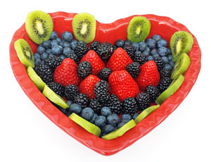 heart shaped bowl of berries