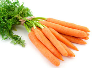 fresh carrots with their carrot tops