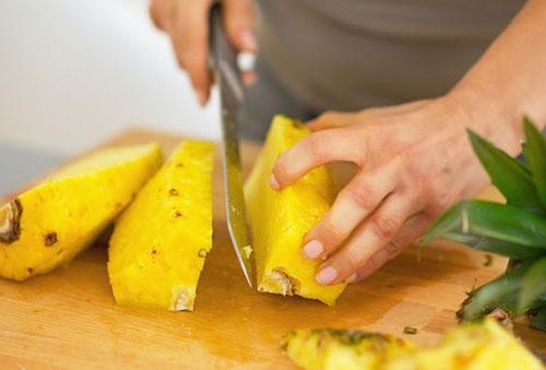 chopping pineapple