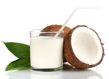 glass of coconut milk with coconuts