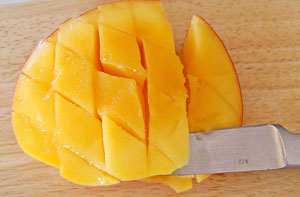 cutting fruit from skin