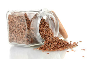 flaxseeds spilling out of jar