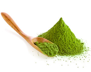 powdered green tea with bamboo spoon
