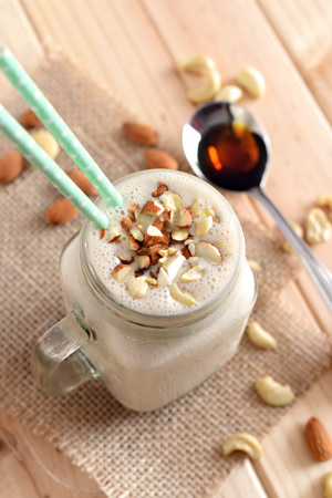 nutty banana smoothie with cashew butter and almonds