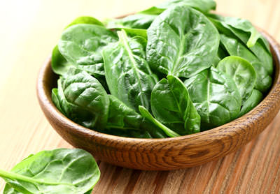 bowl of baby spinach leaves