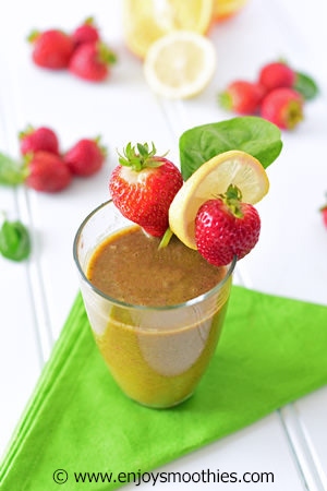 strawberry orange detox smoothie with lemons