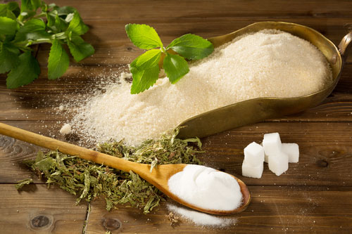 sugar and stevia on a wooden table