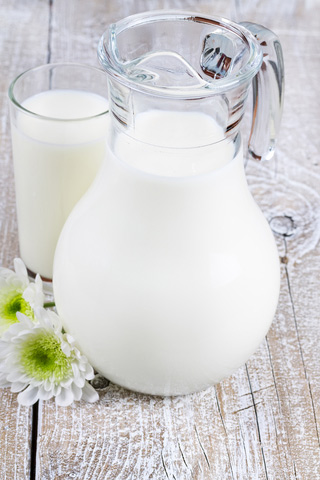 jug of milk with glass